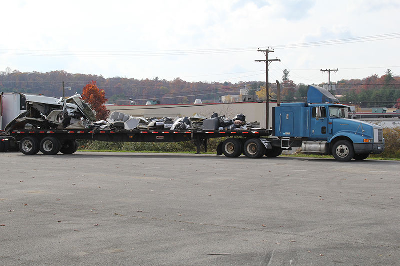 Commercial Towing WV Trailer Bed with Truck Wreckage Professional Cleanup