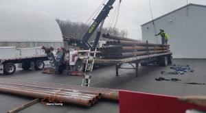 Glens Commercial Towing Offloading metal pipes for a commercial trucking client using a heavy duty rotator Glen's Towing Blog Video